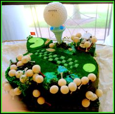 """Groom's Cake with golf ball cake pops - golf course """"fairway"""" with water, sand traps made of brown sugar and other sugar details. Golf balls are cake pops with real tees as sticks."""