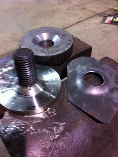 "Dimple Dies by finley31 -- Homemade dimple dies improvised by welding a bolt to a round stock base. Built-up weld bead was chamfered to 45 degrees on a lathe to suit mating female washers. Set consists of 1/2"" and 1"" dies. http://www.homemadetools.net/homemade-dimple-dies"