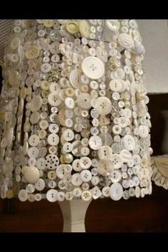 Old lampshade + strings of buttons