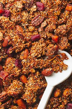 Maple Quinoa Granola! Golden, crunchy, naturally sweetened clustery granola with speckles of quinoa, nuts, coconut, oats, chia, and other delicious, good-for-you things! #breakfast #granola #quinoa