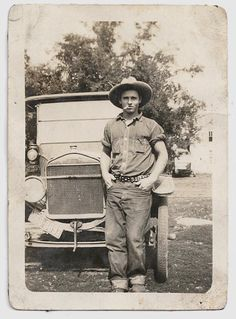 A young farmer poses in front of his car, United States, c.1920s, photographer unknown.