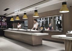 To create the interior for this Parisian McDonalds, Patrick Norguet paired raw concrete and sheet metal with colourful ceiling-mounted light boxes Mcdonald's Restaurant, Restaurant Design, Ceiling Mounted Light, Patrick Norguet, Store Counter, Retail Interior, Champs Elysees, Architecture, Ideas
