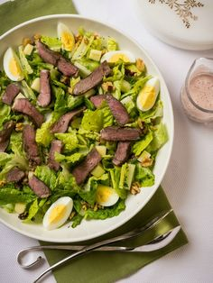 Seder Plate Salad | This is my version of a French Niçoise salad. I make it with lamb instead of tuna, and it contains the ritual components of the Seder plate and table. The dressing is made from kosher sweet wine and maror (the bitter herb, in this case, white horseradish), creating a creamy pink dressing. This salad also makes a nice lunch or light dinner during chol hamoed, the nonholiday days of Passover.