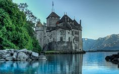 The Little Mermaid in Switzerland: Prince Eric's seaside castle in The Little Mermaid takes strong cues from Switzerland's Château de Chillon, an island fortress along the shores of Lake Geneva, whose stone walls seem to plunge into the surrounding waters.