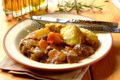 Yummy and easy to make, try this dumplings and mutton curry stew from Robertsons. Add a little Rosemary for a perfect finish to this tasty dish. Lamb Dishes, Curry Dishes, Tasty Dishes, South African Dishes, South African Recipes, Pork Curry Recipe, Curry Recipes, Crockpot Recipes, Cooking Recipes