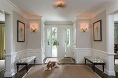 Entry foyer - loving it all - the symmetry, the side-lites, the benches, the closets...