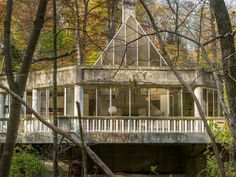 Though the house is in need of some dire repairs—including leaks and a lack of heat and water—it stands proud with its original architecture built entirely of concrete and glass. It cantilevers over the Silvermine River.