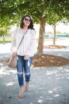 White Blouse with Tassels and Distressed Jeans - via @maeamor