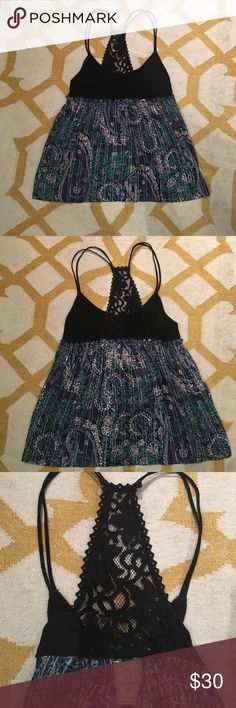 Free People lace racer back top Gorgeous Free People top with a lacy racer back detailing Free People Tops Tank Tops