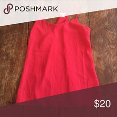 J. Crew Bright red business tank top J.Crew bright red tank top. Great for under blazers. Racerback straps. Model is 5'4 1/2 and usually wears size 0 or 25. Model wears small tops and is 32 A chest. J. Crew Tops Tank Tops