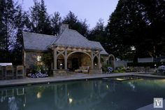 Complementing a brick main house, this pool house designed by Douglas VanderHorn Architects is well-used family space that provides ample opportunity for outdoor fun while maintaining the English Tudor charm of this Connecticut property. Tudor House Exterior, Pool House Designs, Tudor Style Homes, Tudor Homes, Garden Swimming Pool, Pool House Plans, Porch Columns, Pool Cabana, English Tudor