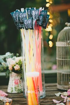 End of the night grand exit send off ideas! Glow Sticks! They stand out in photos are fun for guests to dance with. || Photography by: Be In Love Photography
