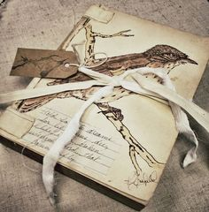 Vintage-look handmade book with a simple tie and handmade tag <3