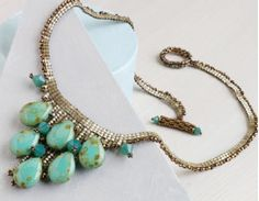 The Cairo Collar, designed by Lynn Davy, is a beautiful modern take on a classic style. This beaded necklace project will challenge your stitching abilities because it incorporates herringbone stitch as well as peyote and ladder stitch!