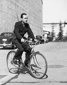 Humphyrey Bogart ... on a bike! Why does this seem so odd to me?