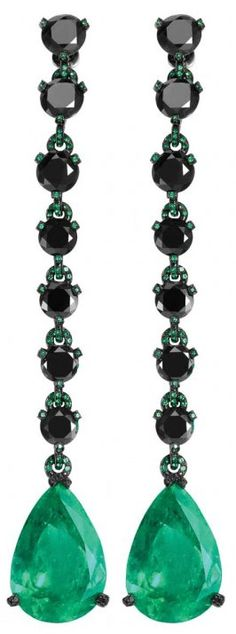 Black diamond and emerald earrings by de Grisogono.    Via CIJ Jewelery Magazine.