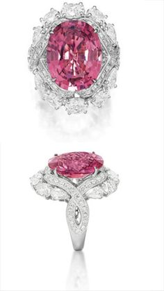 PINK SPINEL AND DIAMOND RING.         Centring on an oval pink spinel weighing 12.26 carats, decorated with variously-shaped diamonds extending to the shoulders, the diamonds together weighing approximately 3.85 carats, mounted in 18 karat white gold.