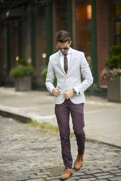Team a grey blazer with burgundy chinos to look classy but not particularly formal. Walnut leather oxford shoes will instantly smarten up even the laziest of looks.  Shop this look for $225:  http://lookastic.com/men/looks/oxford-shoes-and-chinos-and-blazer-and-dress-shirt-and-tie/428  — Walnut Leather Oxford Shoes  — Burgundy Chinos  — Grey Blazer  — White Dress Shirt  — Black Tie