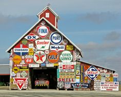 Barn in Iowa clad in Vintage Metal Signs. Colorful Display (barns sky ). Photo by Bubbly