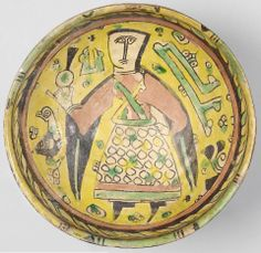 A Nishapur 'buff ware' pottery Bowl Persia, 9th/ 10th Century of rounded form on a short foot, decorated in black, tomato red, yellow and green with a female figure holding a bottle amidst tiny floral sprays, a short kufic inscription above her left shoulder, below the rim a band of continuous chain motif, the exterior below rim with a band of cross-hatching 21.9 cm. diam.