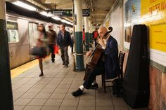 John Mark Rozendaal performed on the Wall Street 4/5 subway platform as part of Bach in the Subways Day on Wednesday. (Daniella Zalcman for The Wall Street Journal)