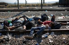 Syrian refugees sleep on railway tracks in Idomeni, Greece as they wait to be processed and allowed over the Macedonian border