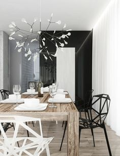 Monochrome dining room with a Heracleum pendant light from Moooi   Vincent Cat