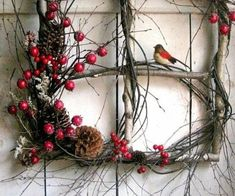 18 Breathtaking Christmas Door Wreaths That Are Begging To Be Stolen By Neighbors — DESIGNED - square wreath – bare twigs with berries, pinecones, a bird – good for Christmas or winter decor - Crochet Christmas Wreath, Christmas Door Wreaths, Diy Fall Wreath, Christmas Door Decorations, Holiday Wreaths, Wreath Ideas, Winter Decorations, Christmas Design, Christmas Crafts