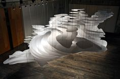 Designed to operate at once as landscape and architecture, the schematic of stacked planes seen from a bird's eye view toggles between topography map and Topography Map, Light Art, Light Bulb, Light Fixture, Cabinet D Architecture, Landscape Model, 3d Laser, Art Design, Installation Art