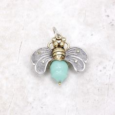 Everyone is simply buzzing about our beautiful Bee Brave Charm from Waxing Poetic! Crafted from various metals including, this lovely little charm will be a great addition to your collection. One of t