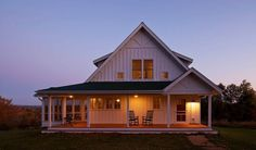 An open porch, a large gable, simple trim, and 2-over-2 windows are all hallmarks of the Farmhouse style