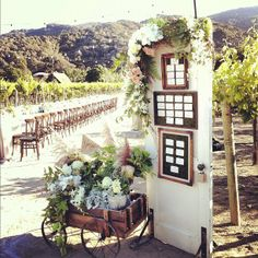 wooden wagon & old door for hanging placecards