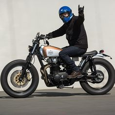 The ultimate in cool, Honda cb750 and rider.  Awesome pin.