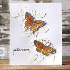 White embossing paste used with Simon Says Stamp's fabulous leaf stencil.  Butterflies were stmped onto watercolour cardstock and heat embossed with silver embossing powder...