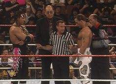 WWE / WWF - WRESTLEMANIA 12 - WWF Champion Bret Hart and Shawn Michaels get instructions from Earl Hebner before their Iron Man Match