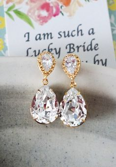 Clear Swarovski Crystal Teardrop (13mm x 18 mm) in Yellow Gold plated settings. Cubic zirconia Teardrop earrings, Yellow Gold plated. 925 sterling