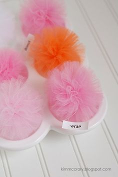 Tulle pom poms.  In white and silver, this would be cute for Christmas garland (just make it small!)