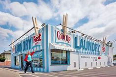 Life is full of wonderful surprises … like the GIANT clothespins on the Coin Op Laundromat in Bellflower SoCal !!! … Long may it stand !!! …