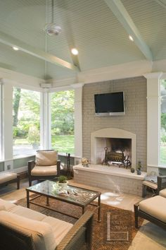 Nashville screen porch with mint green painted ceiling. Love the fireplace on the porch 3 Season Porch, 3 Season Room, Porch Ceiling, Ceiling Beams, Ceiling Beadboard, Porch Fireplace, Grey Fireplace, Porch Addition, Building A Porch
