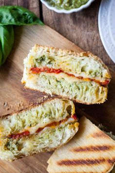 Oven Roasted Tomato and Pesto Panini - This is one of my favorite sandwiches! Fresh pesto, melty cheese, and those slow roasted tomatoes! I can't get enough of this vegetarian sandwich. Best Vegetarian Sandwiches, Veggie Sandwich, Oven Roasted Tomatoes, Food Wishes, Vegan Meal Plans, Veggie Recipes, Veggie Meals, Burger Recipes, Lunch Recipes