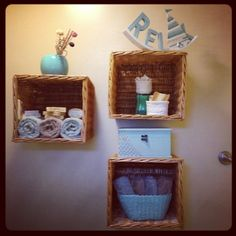 Bathroom decor. DIY shelves from baskets.  I'm not much of a basket person, but this works great for light items.  Maybe milk crates screwed to the wall for books & such.
