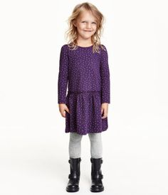 CONSCIOUS. Long-sleeved dress in organic cotton jersey with a printed pattern, long puff sleeves, and wide ruffle at hem.