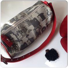 """SYDNEY LOVE NEWSPRINT BARREL BAG Newsprint style statement bag by Sydney Love in black & white with crisp red adjustable strap & accents!  Inside is lined in red & white plaid pattern to add whimsy to the bag!  Large enough to hold plenty of your essentials for a day or night out!! Images from the 70's to 80's are the theme & include a very young Boy George, Christie Brinkley, Andy Warhol & Marlon Brando (The Contender). The bags theme is """" Oh Boy..George is back in fashion"""". Very cute bag…"""