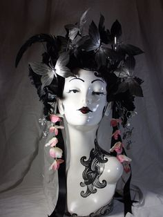 Black and silver butterfly crown, headdress, with black ostrich feathers and faux black flowers. on Etsy, $120.00