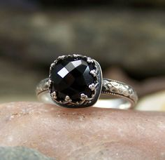 Black Garnet called Melanite.  Ring has a goth feeling to it
