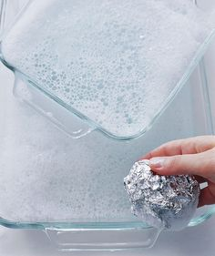 Use Aluminum Foil to Scrub Off Baked-On Food  If you have remnants of your casserole stuck to your baking dish, wad a clean piece of foil—maybe one you used to keep a plate of food warm while the rest of dinner cooked?—into a ball, then use it with few drops of dishwashing liquid to scrub glass cookware clean.