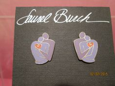 Check out this item in my Etsy shop https://www.etsy.com/listing/221122681/laurel-burch-sanctuary-pierced-earrings