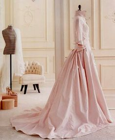 Pretty pink gown with menswear inspired bodice.