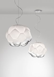 """The Cloudy """"cloud"""", when switched on, reveals all of its luminosity and evokes sunlight after the rain. A design lamp containing in itself a positive sign of hope and optimism. Cloudy's blown glass st"""