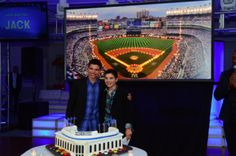 "Simon Elliot Events created a 4 x 8 illuminated framed piece of artwork for this Yankee themed Bar Mitzvah candle lighting ceremony. Each guest was called up by a Bob Shepard voice impersonator and the plasma screen read, ""Now Batting""…with their name. As they lit each candle, a button was pressed and a different section of Yankee Stadium became illuminated."